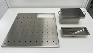 <b>Perforated shelf for DX formalin funnel</b><br />P/N: 106652